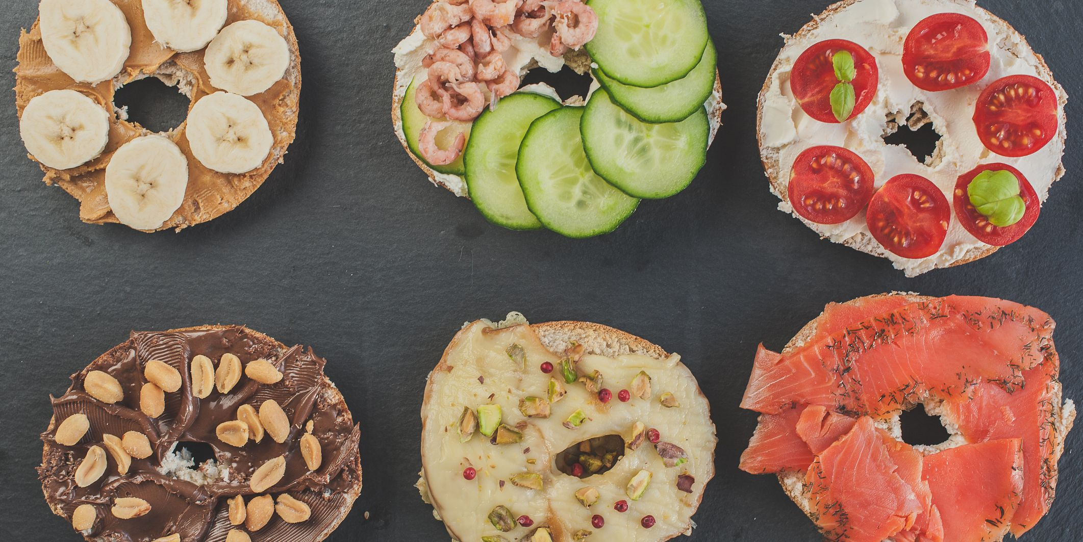 Variety of sweet and salty bagels, top view flat lay