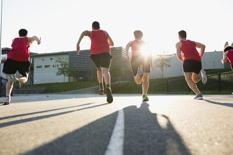 High school track and field athletes running track