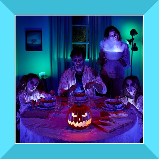 led halloween mask and family dressed as zombies for halloween