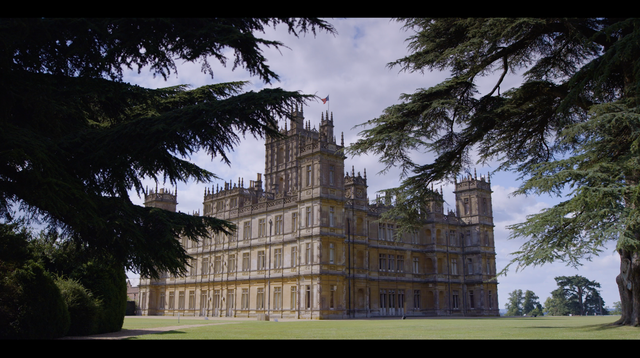 highclere castle framed by trees