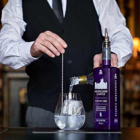 Product, Drink, Bartender, Distilled beverage, Alcohol, Bar, Bottle, Cocktail, Liqueur, Formal wear,