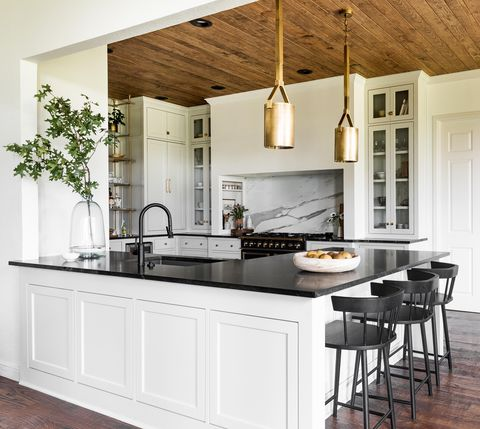 tradition kitchen with black, white, and wood palette