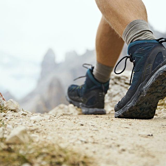 Hiker on dirt track, Canazei, Trentino-Alto Adige, Italy