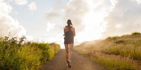 Woman Running Up a Hill