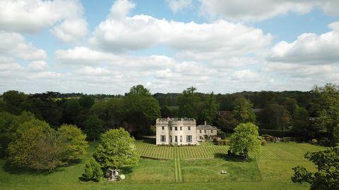 Estate, Property, Natural landscape, House, Sky, Grass, Building, Garden, Tree, Manor house,