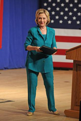 Standing, Flag, Suit trousers, Floor, Electric blue, Podium, Curtain, Public speaking, Lectern, Active pants,