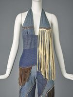 Melody Sabatasso for Love, Melody Originals, woman's pantsuit, circa 1970, of pieced recycled denim with leather and suede fringe and Swarovski rhinestones.
