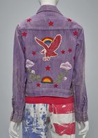 "The back of Helene Robertson's customized ""Farah of Texas"" jacket, circa 1960s, with cotton patches and metal studs, and silkscreened Levi's denim jeans, circa 1960s. Both come from the collection of Helene Robertson."