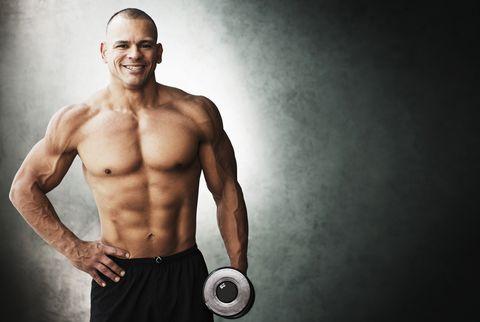 Hispanic athlete lifting weights