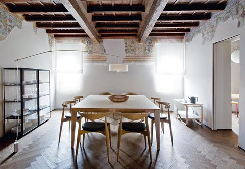 FOR THE DINING AREA, THE 45° DISPLAY CASES, DESIGNED BY RON GILAD FOR MOLTENI&C, MADE TO MEASURE TABLE BY ANGELO MANGIAROTTI FOR AGAPE CASA, WITH CH20 CHAIRS BY HANS J. WEGNER. LIGHT BY DEPADOVA, TROLLEY BY ARTEK. ANTIQUE OAK FLOOR FINISHED WITH OIL.