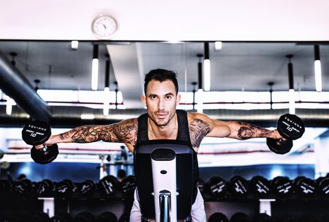 Gym, Physical fitness, Shoulder, Fitness professional, Arm, Weight training, Sport venue, Weights, Muscle, Room,