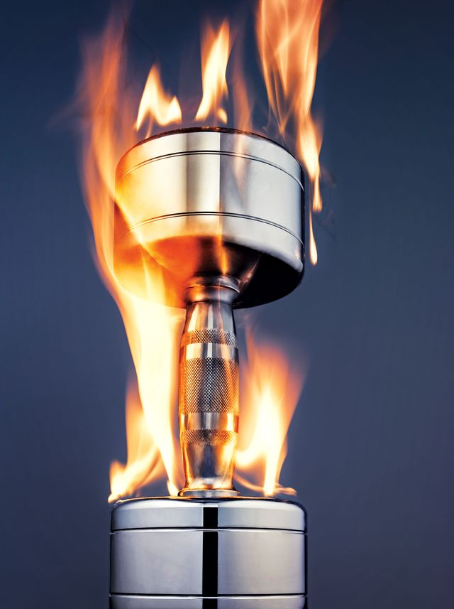 silver dumbbell with flames superimposed