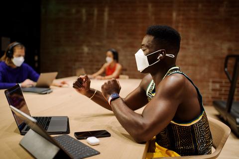 man wearing mask rehearses exercises