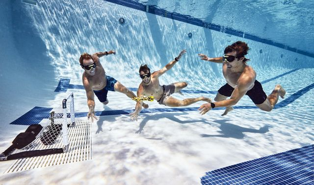pool workout playing a game of underwater torpedo