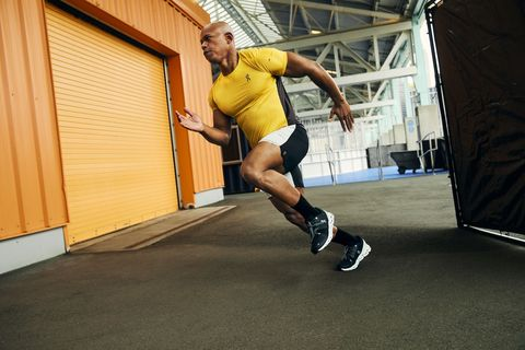 light speed sprint jahkeen washington performing sprint shirt, shorts, and sneakers by on