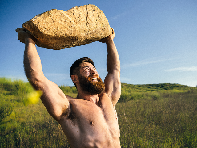 man lifting rock