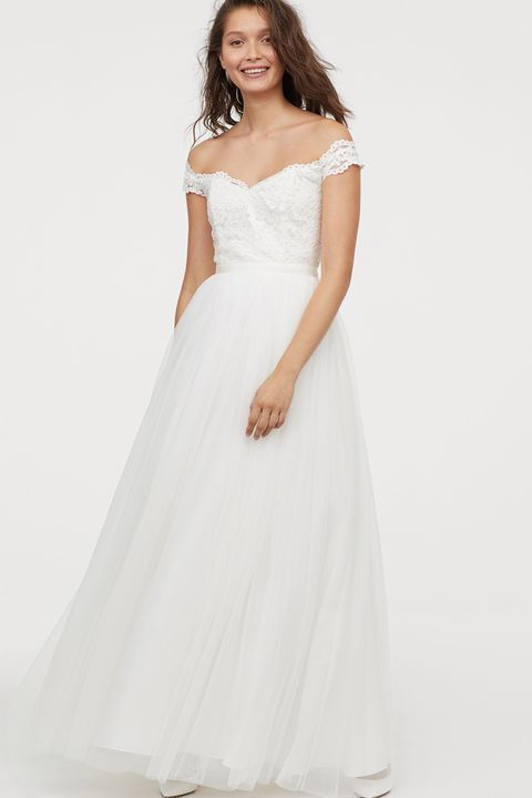 Gown, Wedding dress, Clothing, Dress, Fashion model, White, Shoulder, Bridal party dress, Bridal clothing, Photograph,