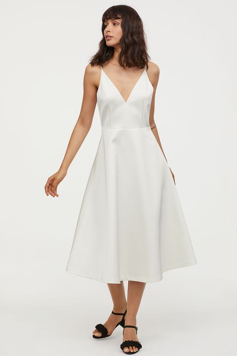 Clothing, Dress, Fashion model, White, Shoulder, Day dress, Bridal party dress, Cocktail dress, Gown, A-line,