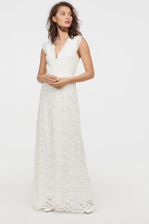 Clothing, Dress, Gown, White, Wedding dress, Bridal party dress, Fashion model, Day dress, Bridal clothing, Neck,