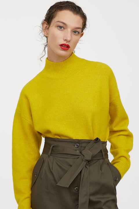 Clothing, Yellow, Neck, Sleeve, Fashion, Waist, Orange, Outerwear, Fashion model, Blouse,