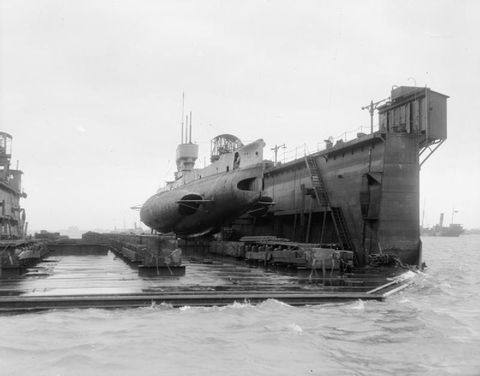 HMS E34, a British E-class submarine in a floating dock. She was commissioned in March 1917, sank the U-Boat UB-16 off Harwich in the North Sea on 10 May 1918, and was mined near the the Frisian islands on 20 July 1918. The sub was lost with all the crew.