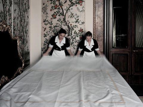 Textile, Gown, Interior design, Fashion, Door, Black hair, Wedding dress, Linens, Bridal clothing, Haute couture,