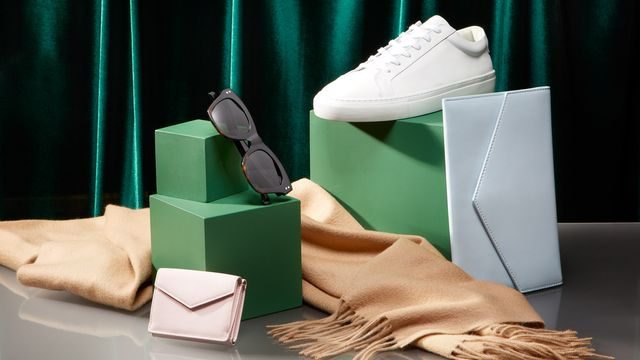 several italic products including italic sneakers, sunglasses, and wallets stacked for an italic review