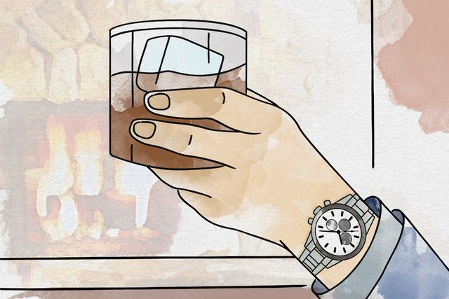 hand holding whiskey wearing hodinkee watch