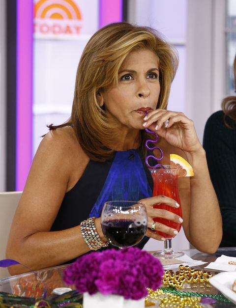 today show host hoda kotb drinking a hurricane out of a purple straw