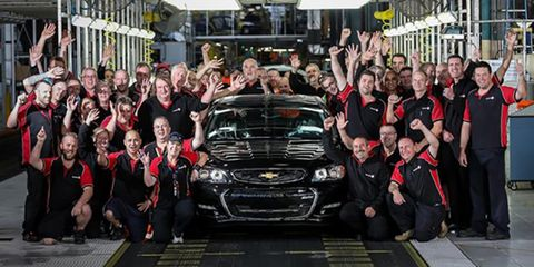 People, Vehicle, Automotive design, Social group, Crowd, Grille, Team, Bumper, Hood, Luxury vehicle,