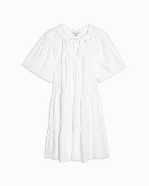 still life shot of white smock dress cotton mini by topshop   £29