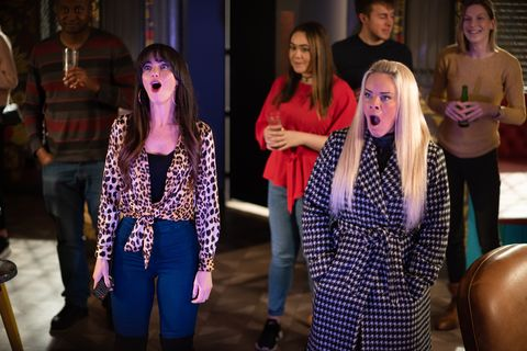 Mercedes McQueen and Grace Black watch Scott Drinkwell impersonate them in Hollyoaks