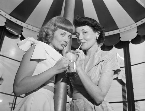 two models share milkshake
