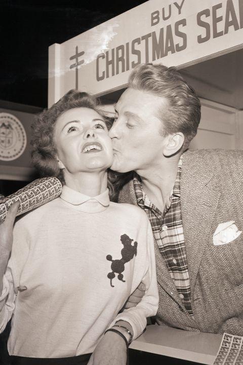 Kirk Douglas Kissing a Seal Customer