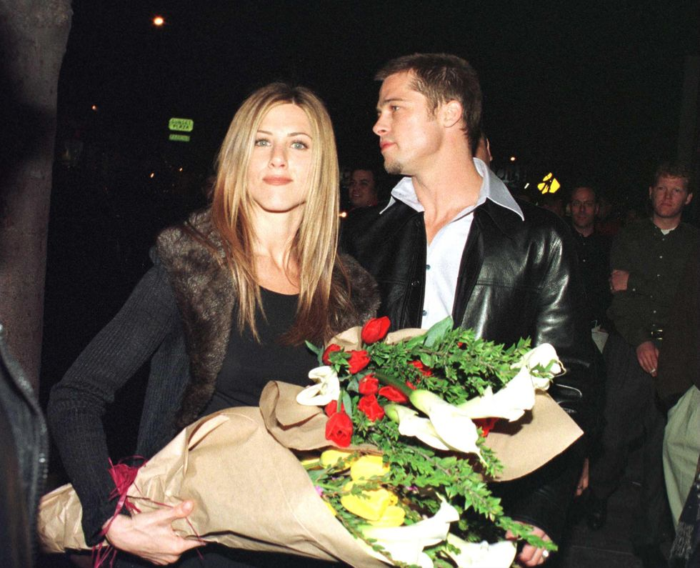 """1999: The New """"It"""" Couple Pitt and Jennifer Aniston reportedly met after Pitt had their agents set them up on a date in 1998. Here they are leaving Los Angeles' Barfly nightclub, where he threw her a massive 30th birthday party in February 1999."""