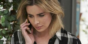 Chelsea Campbell receives a phone call in Home and Away
