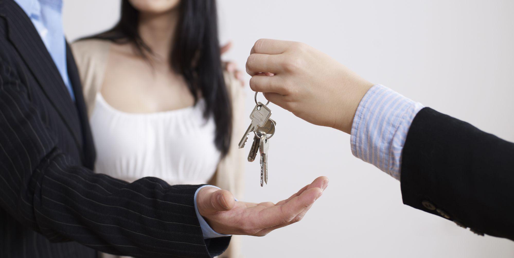 home buyers getting house keys