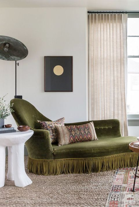 living room with green chaise