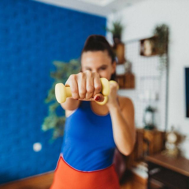 young woman boxing at home