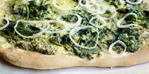 home made pizza with lemon balm pesto, spinach and vegan cheese
