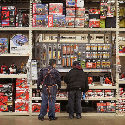 a worker helps a customer in the garden center at a home depot store on february 15, 2011 in chicago, illinois