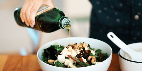 homemade gourmet food fresh green salad with mozzarella, mixed nuts and dry fruits