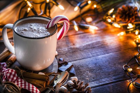 Homemade hot chocolate mug shot on rustic wooden Christmas table
