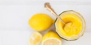 Homemade lemon curd with lemons