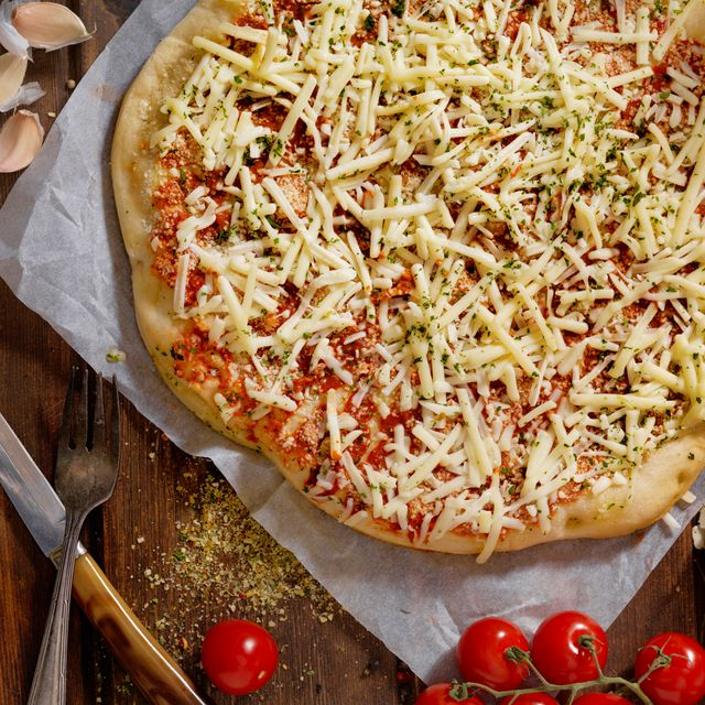 homemade pizza with shredded cheese