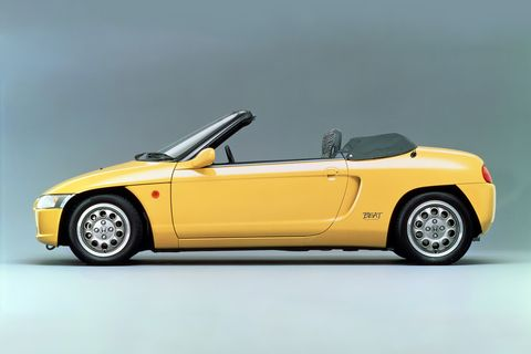 Land vehicle, Vehicle, Car, Yellow, Sports car, Convertible, Model car, Automotive design, Coupé, Roadster,