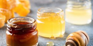 Honey In Jar With Wooden Honey Dipper, Liquid Honey