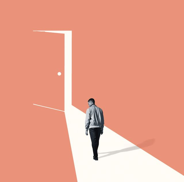man walking towards doorframe