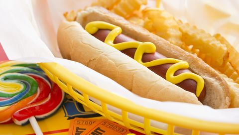 Hot dog with french fries in basket