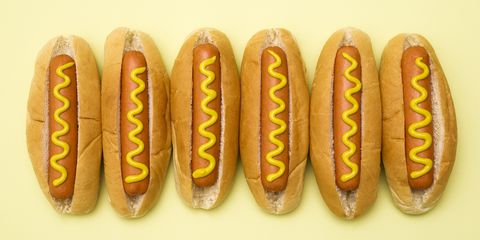 Hot dogs against a plain background